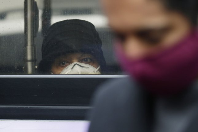 Masks, distancing still needed as cities reopen, even with vaccinations, researchers say