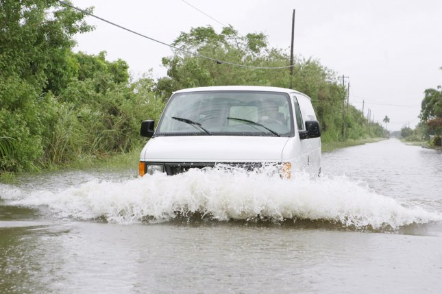 A van tries through flood waters in Miami, Florida. The area is expecting floods brought by the seasonal king tides. Photo by Michael Bush/UPI