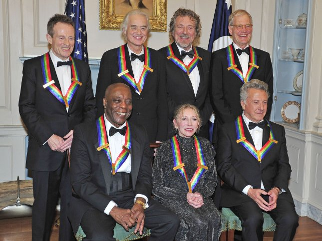 The seven recipients of the 2012 Kennedy Center Honors pose for a photo following a dinner hosted by United States Secretary of State Hillary Rodham Clinton at the U.S. Department of State in Washington, D.C. on Saturday, December 1, 2012. The 2012 honorees are Buddy Guy, actor Dustin Hoffman, late-night host David Letterman, dancer Natalia Makarova, and the British rock band Led Zeppelin (Robert Plant, Jimmy Page, and John Paul Jones). From left to right, back row: John Paul Jones, Jimmy Page, Robert Plant, and David Letterman. From left to right, front row: Buddy Guy, Natalia Makarova, and Dustin Hoffman. UPI/Ron Sachs/Pool