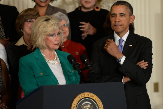 Equal pay activist Lilly Ledbetter makes a compliment to President Barack Obama during her remarks before Obama signed two executive orders regarding equal pay for women at an event in the East Room of the White House in Washington, DC on April 8, 2014. Obama signed the Lilly Ledbetter Fair Pay Act of 2009, and the U.S. Senate will debate the Paycheck Fairness Act tomorrow. UPI/Pat Benic
