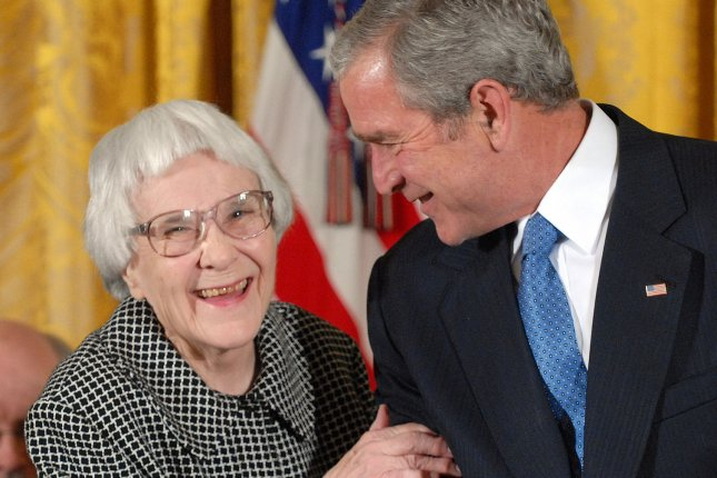U.S. President George W. Bush awards the Presidential Medal of Freedom to Harper Lee, author of To Kill a Mockingbird, in the East Room of the White House in Washington on November 5, 2007. An online petition is seeking to have a building at the University of Alabama renamed in her memory. (UPI Photo/Roger L. Wollenberg)