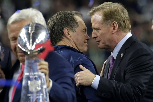 New England Patriots coach Bill Belichick and NFL Commissioner Roger Goodell  exchange words during the Vince Lombardi trophy ceremony after the Patriots  ... 7eaa2bd60