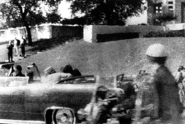 President John F. Kennedy slumps into the arms of his wife, Jackie, immediately after he was shot as his motorcade made its way through Dealey Plaza in Dallas on Nov. 22, 1963. Two lawmakers have introduced resolutions pushing President Donald Trump to release all remaining records relating to the JFK assassination. UPI File Photo