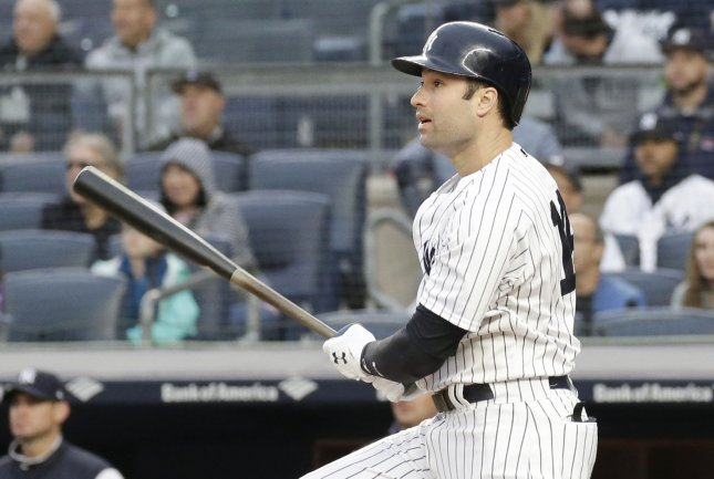 Neil Walker of the New York Yankees hits a walk off game-winning RBI single in the 11th inning against the Oakland Athletics at Yankee Stadium in New York City on May 12. Photo by John Angelillo/UPI