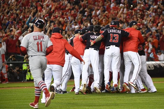 The Washington Nationals celebrate after beating the St. Louis Cardinals in the National League Championship Series on Tuesday at Nationals Park in Washington, D.C. Photo by Kevin Dietsch/UPI