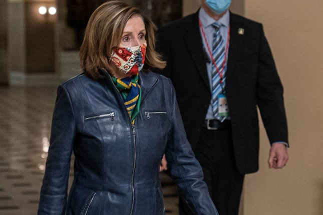 House Speaker Nancy Pelosi walks to the House floor at the U.S. Capitol in Washington, D.C., on December 18. Pelosi said she will try for a roll-call vote on Monday in a bid to raise stimulus payments to Americans. Photo by Ken Cedeno/UPI