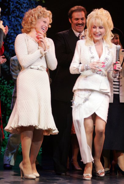 Actress Dolly Parton, who wrote the music and lyrics for the Broadway musical production of 9 to 5 takes her opening night curtain call bows with cast member Megan Hilty (l) at the Marquis theatre in New York on April 30, 2009. (UPI Photo/Ezio Petersen)
