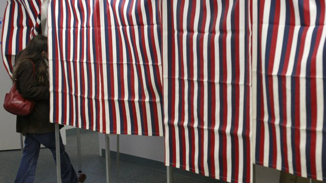 A voter walks into a voting booth in Nashua, New Hampshire on January, 10 2012. UPI/Matthew Healey