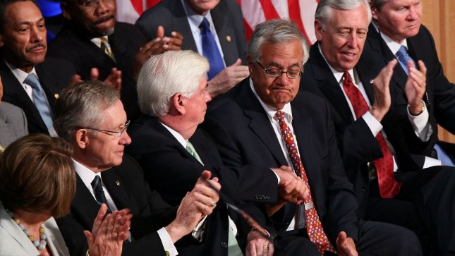 Rep. Barney Frank (D-MA) (3rd R) and Sen. Chris Dodd (D-CT) (5th L) shake hands after being thanked by U.S. President Barack Obama before he signed the Dodd-Frank Wall Street Reform and Consumer Protection Act at the Ronald Reagan Building and International Trade Center on July 21, 2010 in Washington, DC. UPI/Win McNamee/Pool