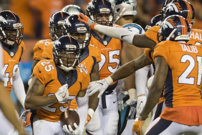 Denver Broncos' Chris Harris, Jr. (25) reacts after intercepting Carolina Panthers pass in the fourth quarter at the NFL's season opener and Super Bowl 50 rematch at Sports Authority Field at Mile High in Denver on September 8, 2016. Denver beat Carolina 21-20. Photo by Gary C. Caskey/UPI