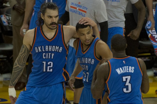 Oklahoma City Thunder's Steven Adams (12).celebrates with Andre Roberson (21) and Dion Waiters (3) after upsetting the Golden State Warriors in game 1 of the NBA Western Conference Finals at Oracle Arena in Oakland, California on May 16, 2016. Photo by Terry Schmitt/UPI