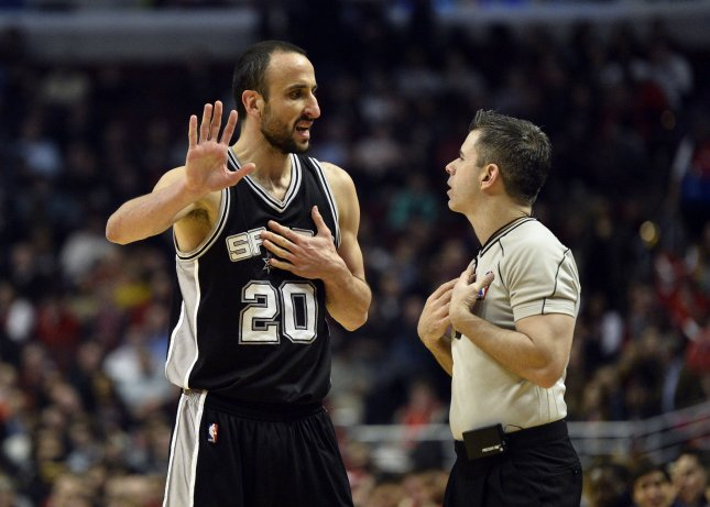 San Antonio Spurs guard Manu Ginobili talks with referee during a game last season. Ginobili, 40, re-signed with the Spurs on Thursday. Photo by Brian Kersey/UPI