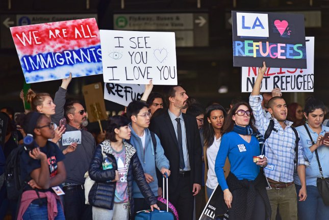 Protesters rally against President Trump's new immigration order in front of the Tom Bradley Terminal at the Los Angeles International Airport in Los Angeles, California in January. On Saturday, a federal judge partially lifted a Trump administration ban on certain refugees. Photo by Christine Chew/UPI