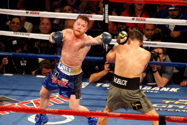 Canelo Alvarez throws a jab at Gennady Golovkin during their Sept. 2017 fight. Alvarez has been ordered to make a mandatory defense of his title against Sergiy Derevyanchenko within the next three months. File Photo by James Atoa/UPI