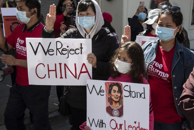Protesters line the sidewalk in front of the Chinese Consulate in San Francisco in March to protest China's alleged involvement in the military coup in Myanmar. China has offered a muted response to the Feb. 1 coup. File Photo by Terry Schmitt/UPI