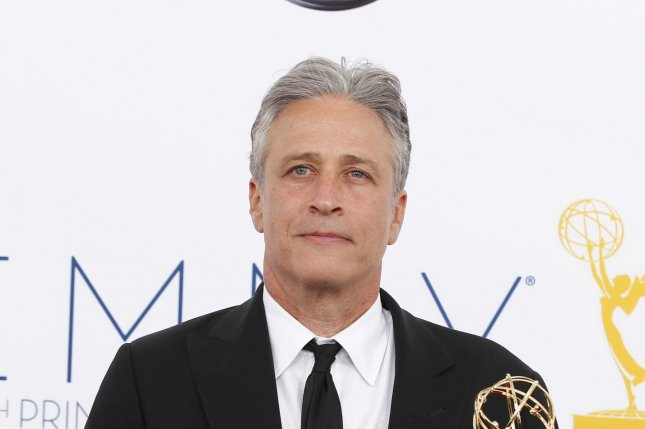 Jon Stewart appears backstage with his Emmy at the 64th Primetime Emmy Awards at the Nokia Theatre in Los Angeles on September 23, 2012. File photo by Danny Moloshok/UPI