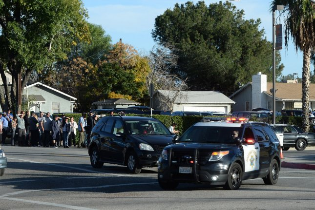 Police block streets as they search for three gunmen who killed at least 14 people in San Bernardino, Calif., on Wednesday. The gunmen opened fire at the Inland Regional Center, a social development center that serves people with development disabilities. Photo by Jim Ruyman/UPI