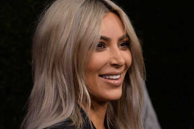 Kim Kardashian responded on Twitter to rumors she and Kanye West partied on New Year's Eve while son Saint West was sick with pneumonia. File Photo by Jim Ruymen/UPI