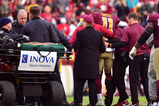Washington Redskins quarterback Alex Smith (11) is helped off the field after being injured in the third quarter against the Houston Texans on November 18 at FedEx Field in Landover, Maryland. Smith could possibly miss the entire 2019 season due to the injury. Photo by Kevin Dietsch/UPI