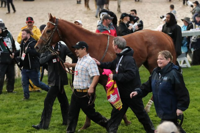 Grooms of Country House lead him to the winner's circle after be was declared winner 145th running of the Kentucky Derby at Churchill Downs on Saturday in Louisville. He might enter the Preakness. Photo by John Sommers II/UPI