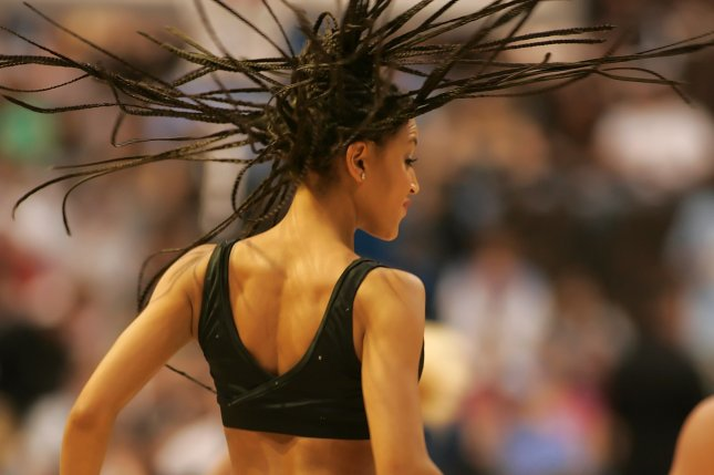 The county statute bans discrimination based on hairstyles associated with race. The law specifically notes certain styles, such as the braids worn by this Denver Nuggets team dance member. File Photo by Gary C. Caskey/UPI