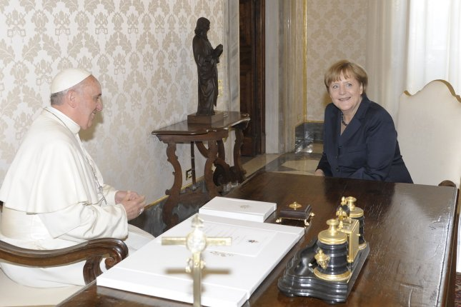 Pope Francis (L) meets with German Chancellor Angela Merkel during a private audience at the Vatican in Vatican City, May 18, 2013. UPI/Stefano Spaziani