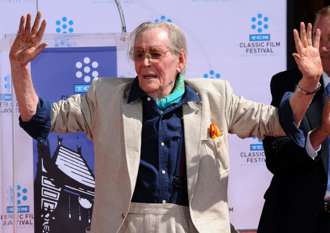 Irish-born actor Peter O'Toole displays his cement-covered hands after placing them in cement during a hand and footprint ceremony honoring him at Grauman's Chinese Theatre in the Hollywood section of Los Angeles on April 30, 2011. The ceremony was part of the 2011 TCM Classic Film Festival honoring classic films and movie stars. UPI/Jim Ruymen