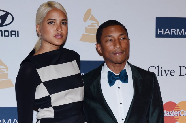 Singer Pharrell Williams And Helen Lasichanh Had Commitment Ceremony In Miami After Secret August Wedding France UPI Jim Ruymen