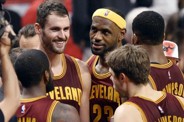 Cleveland Cavaliers forward LeBron James (C) talks with forward Kevin Love (L) and the rest of his teammates. UPI/Brian Kersey