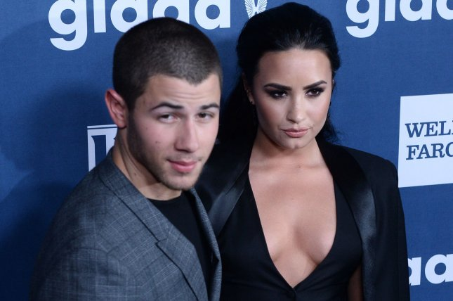 Demi Lovato (R) and Nick Jonas at the GLAAD Media Awards on April 2. The longtime friends gave a joint interiew for the new issue of Billboard. File Photo by Jim Ruymen/UPI