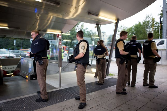 Special police forces stand by the entrance to a subway station following shootings at a shopping mall earlier on Friday in Munich. Nine people were killed and the gunman killed himself. Photo by Michael Trammer/ UPI
