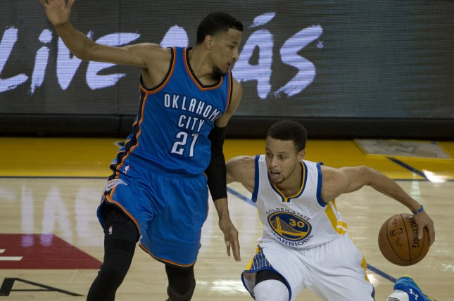 Golden State Warriors guard Stephen Curry (30) drives on Oklahoma City Thunder's Andre Roberson (21). File photo by Terry Schmitt/UPI