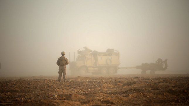 Coalition forces in Syria say a Russian air strike targeted a known position of the Syrian Democratic Forces on Saturday, injuring SDF fighters. Pictured, a U.S. Marine waits to guide a troop movement armored vehicle towing an M777-A2 Howitzer to a firing position in an undisclosed location in Syria on May 14, 2017. File photo by Sgt. Matthew Callahan/U.S. Marine Corps/UPI