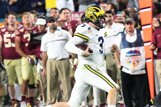 Former Michigan Wolverines quarterback Wilton Speight runs against the Florida State Seminoles in the fourth quarter of the 2016 Capital One Orange Bowl on December 30, 2016 at Hard Rock Stadium in Miami Gardens, Florida. File photo by Gary Rothstein/UPI