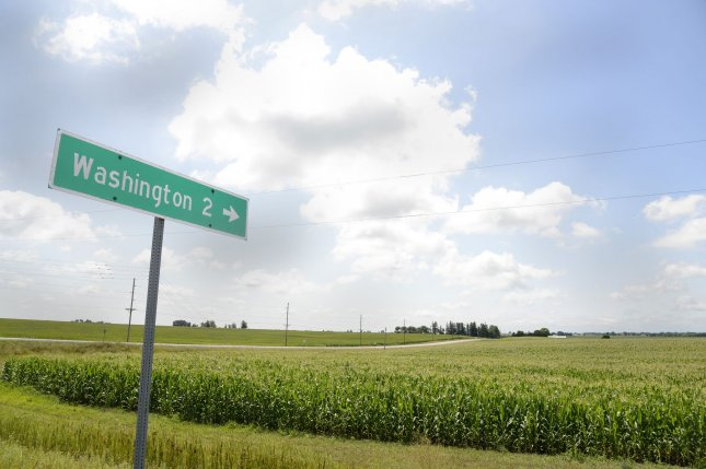 A sign post points the way to rural Washington, Iowa, in Washington County, a long way from Washington, D.C, on August 6. File Photo by Mike Theiler/UPI