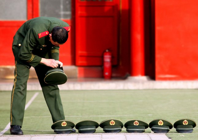 A Chinese People's Liberation Army soldier does daily chores outside military barracks in Beijing February 26, 2011. Security in China's capital remains on a high level after calls for protests as the authoritarian government enforced its crackdown against any Middle East-style democracy movement. UPI/Stephen Shaver