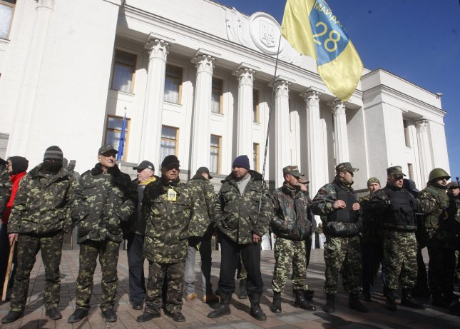 Ukrainian self-defense volunteers stand outside the Parliament building in Kiev after a March 16, 2014, referendum in which the people of Crimea voted overwhelmingly for the peninsula to leave Ukraine and join Russia. File Photo by Ivan Vakolenko/UPI