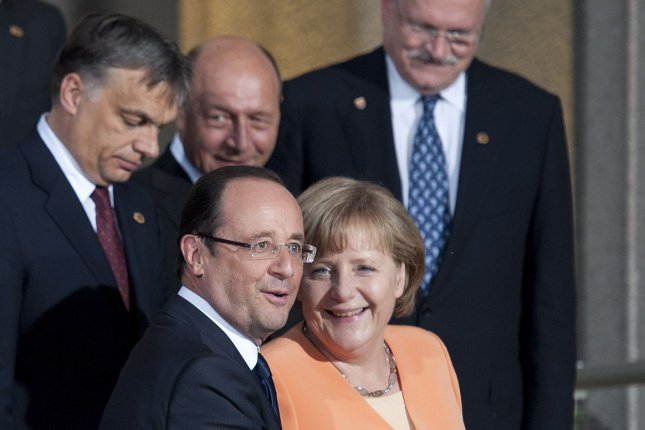 French President Francois Hollande (L) and German Chancellor Angela Merkel. Germany and France announced on Tuesday, May 19, 2015 they would push for a strengthened agreement on climate change at an upcoming United Nations summit. File Photo by Brian Kersey/ UPI.