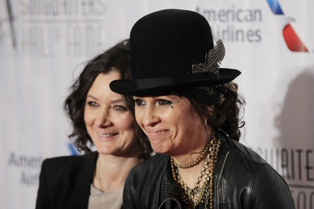 Sara Gilbert (L) and wife Linda Perry at the Songwriters Hall of Fame induction ceremony on June 18. The couple brought son Rhodes along to a family event Sunday. File photo by John Angelillo/UPI