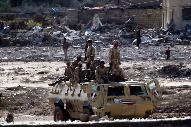 Egyptian army forces patrol amid debris on the Egyptian side of the Sinai Province border town of Rafah, as seen from the Palestinian side in the southern Gaza Strip on Nov. 1, 2014. At least two Egyptian security personnel and 55 militants were killed during a counter-terrorism operation in Rafah and other villages in the Sinai Province on Tuesday, according to the Egyptian military. File photo by Ismael Mohamad/UPI