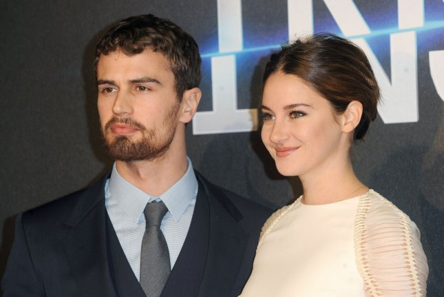 Shailene Woodley (R) and Theo James at the London premiere of Insurgent on March 11. The co-stars appear in new The Divergent Series: Allegiant posters. File Photo by Paul Treadway/UPI