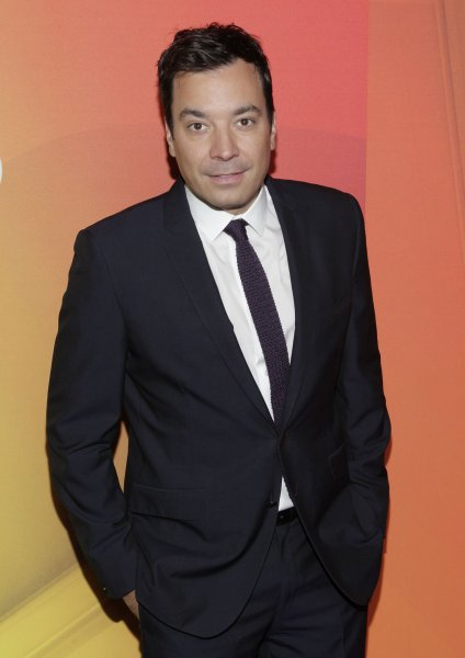 Jimmy Fallon arrives on the red carpet at NBC's Upfront Presentation in 2014. He played a new version of Flip Cup with Liam Hemsworth on The Tonight Show on Monday night. File Photo by John Angelillo/UPI