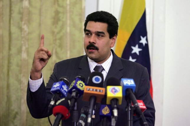 Venezuelan President Nicolas Maduro was ordered Tuesday by Caracas' parliament to stand trial on charges of violating the Constitution, which opponents claim he did by scuttling a referendum vote last week on whether to recall him and remove him from office. Maduro's regime answered the vote by saying the parliament has no legitimate authority. File Photo by Mohammad Kheirkhah/UPI
