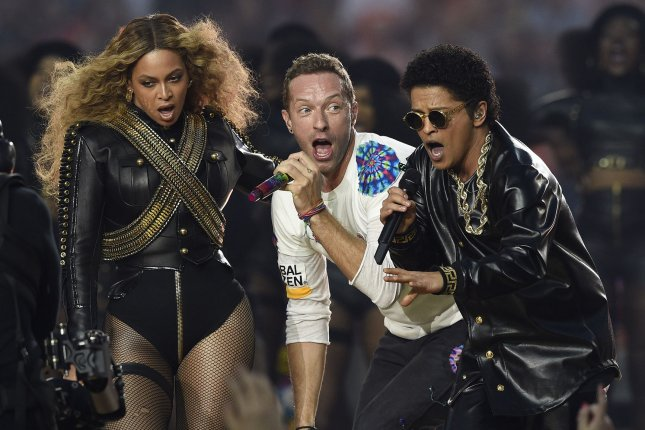 Bruno Mars, pictured at right with Beyonce and Coldplay lead singer Chris Martin performing at the Super Bowl 50 halftime show in 2015, has been accused of copyright infringement with Mark Ronson for the track Uptown Funk for the third time. The new suit, filed by band Collage, alleges the song is basically a rip-off of their track Young Girls. File photo by Brian Kersey/UPI
