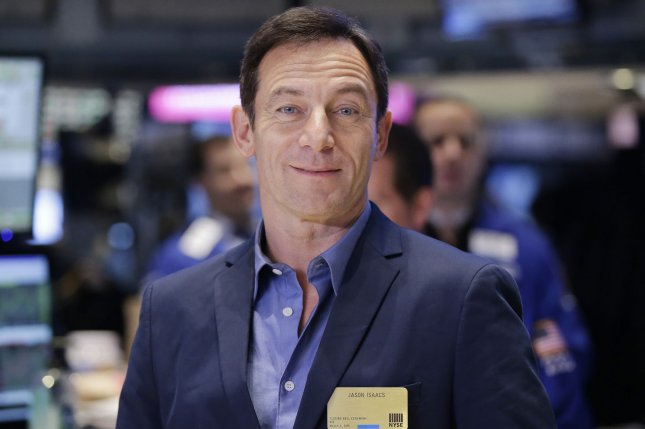 Jason Isaacs stands on the floor of the NYSE before he rings the Closing Bell to Celebrate Premiere of USA Network's DIG on March 5, 2015. Isaacs joined up with fellow Harry Potter stars Tom Felton and Matthew Lewis at the Universal Orlando Resort. File Photo by John Angelillo/UPI
