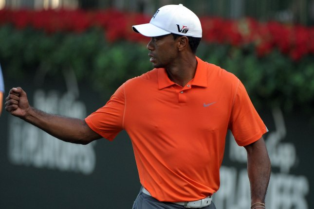 Tiger Woods pumps his fist on No. 18 during the first round of the PGA Tour Championship on September 19, 2013 at East Lake Golf Club in Atlanta. Woods finished at 3-over-par while Henrik Stenson posted a 6-under-par round to take the lead. UPI/David Tulis