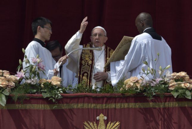 Pope Francis delivers the Urbi et Orbi -- to the city and the world -- benediction during Easter Mass in Saint Peter's Square at the Vatican on Sunday. Photo by Stefano Spaziani/UPI