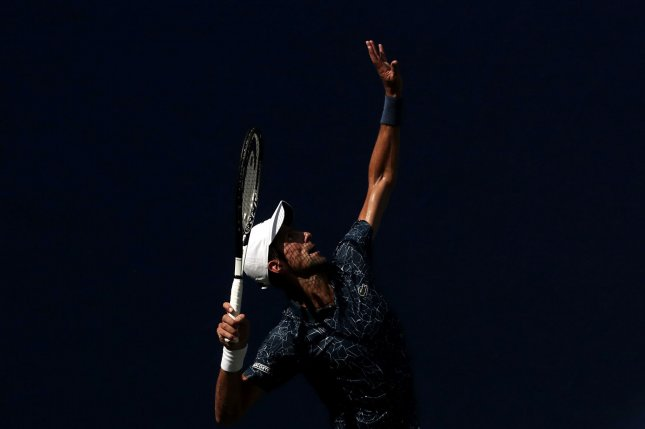 Novak Djokovic of Serbia serves in his first round match against Marton Fucsovics of Hungary in Arthur Ashe Stadium at the 2018 US Open Tennis Championships on Tuesday at the USTA Billie Jean King National Tennis Center in New York City. Photo by John Angelillo/UPI
