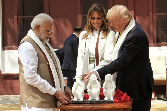 President Trump (R) and first lady Melania Trump are shown the Three Wise Monkeys by Indian Prime Minister Narendra Modi during their visit to Sabarmati Ashram on Monday. Modi gave the see no evil, hear no evil, speak no evil monkey statue to Trump while on his two-day visit. Photo by Raj Patel/UPI