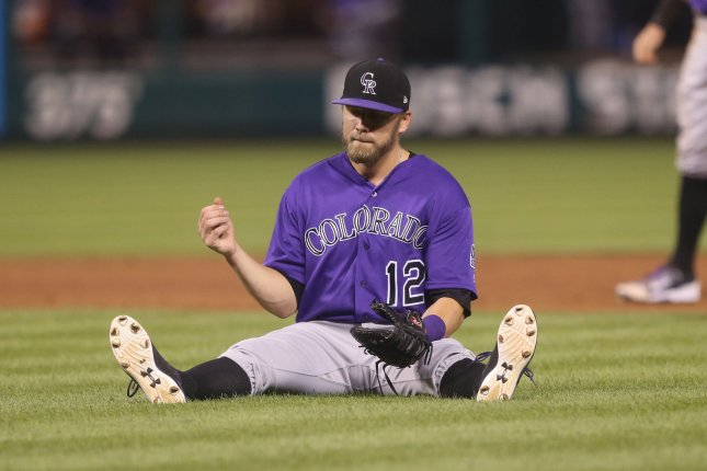 Colorado Rockies infielder Mark Reynolds sits after a botched play in the eighth inning against the St. Louis Cardinals at Busch Stadium in St. Louis, on July 24, 2017. File Photo by Bill Greenblatt/UPI